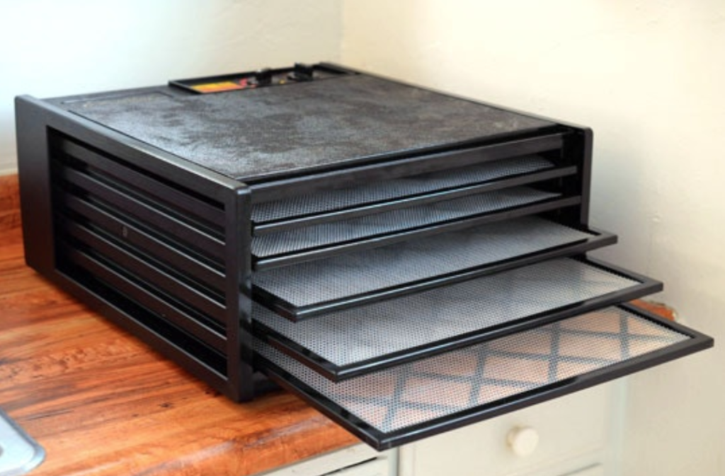 The smaller, 5-tray model without any food in it